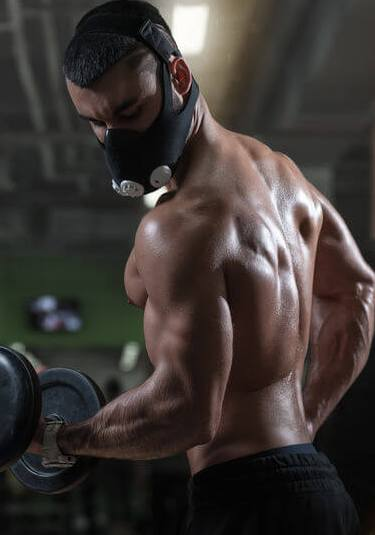 bodybuilding with a mask in gym